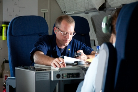 Concentrating - definitely not sleeping! - during a media overflight of the Deepwater Horizon oil spill, June 2010.