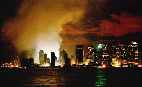 The skyline of Manhattan is pictured early September 15, 2001 with smoke billowing from the wreckage of the World Trade Center's twin towers. Photo by the author.
