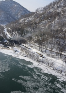Response crews for the West Virginia train derailment continue to monitor the burning of the derailed rail cars near Mount Carbon next to the Kanawha River, Feb. 18, 2015. The West Virginia Train Derailment Unified Command continues to work with federal, state and local agencies on the response efforts for the train derailment that occurred near Mount Carbon, Feb. 15, 2015. (U.S. Coast Guard photo by Chief Petty Officer Angie Vallier)