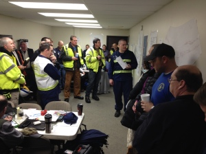 The incident management organization conducts an operations meeting at the command post for the crude oil train derailment. Photo courtesy of Thomas McKenzie.
