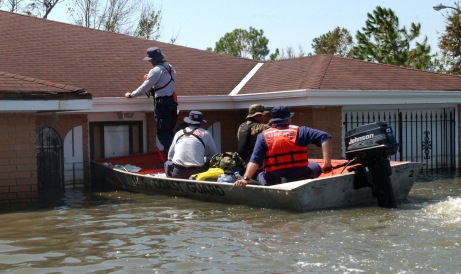"A Coast Guard Disaster and Response Team or ""DART"" works with an Urban Search and Rescue Team from Miami to carry out the tedious job of marking houses they've searched for survivors or bodies."