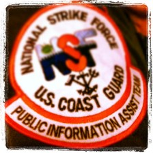 Shoulder patch of the Coast Guard's Public Information Assist Team